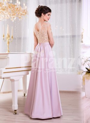 Women's lacy beige bodice evening gown with long metal mauve skirt side view