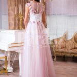 Women's light pink evening gown with long tulle skirt and pink flower appliquéd bodice back side view