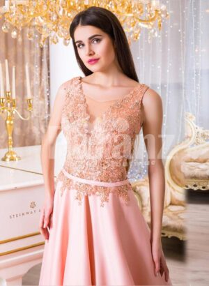 Women's long evening glam gown with royal rhinestone bodice in peach hue