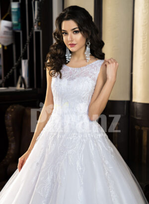 Women's milk-white high volume tulle skirt wedding gown with pleasing bodice cloase view