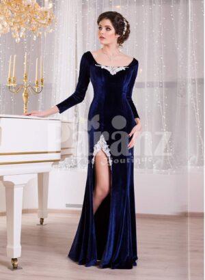 Women's navy velvet floor length evening gown with elegant white lace works