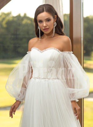 Women's pearl white off-shoulder glam tulle frill wedding gown close view