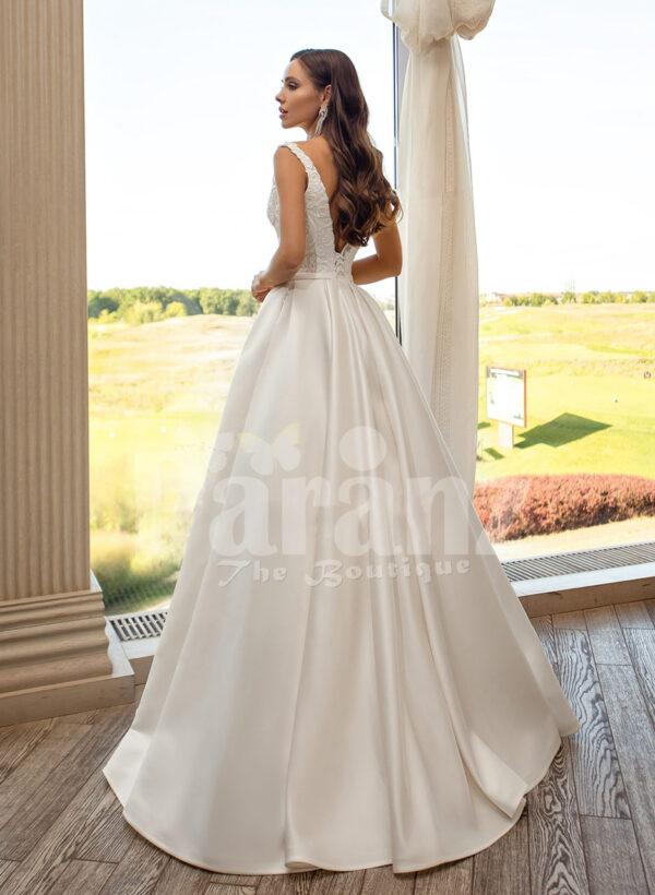 Women's pearl white rich satin flared skirt wedding gown with tulle skirt underneath back side view
