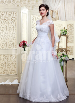 Women's princess style rich white satin floor length wedding gown with tulle skirt underneath