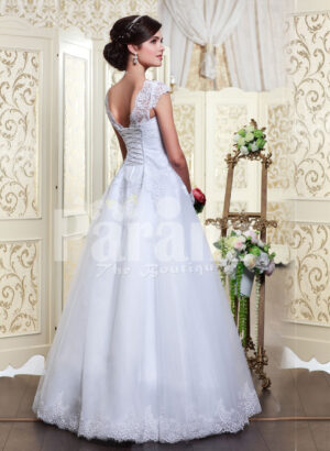 Women's princess style rich white satin floor length wedding gown with tulle skirt underneath back side view