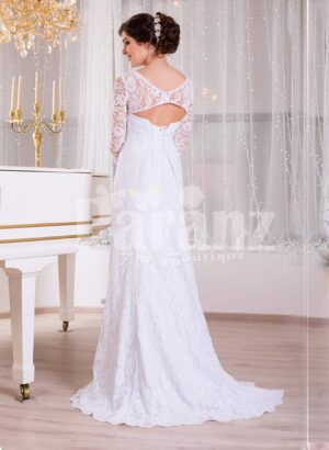 Women's pure white floor-length side slit rich satin gown with all over royal lacework back side view