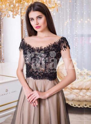 Women's rich black lace royal bodice evening gown with soft and sleek tulle skirt