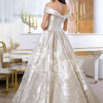 Women's rich satin flared and floor length silver satin gown with all over floral appliqués back side view