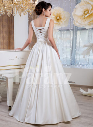 Women's rich satin floor length white wedding gown with tulle skirt underneath back side view