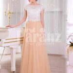 Women's rich white rhinestone work bodice elegant evening gown with peach tulle skirt