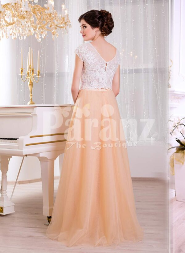 Women's rich white rhinestone work bodice elegant evening gown with peach tulle skirt back side view