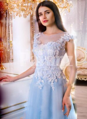 Women's sky blue floor length evening gown with tulle skirt and floral bodice close view