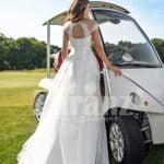 Women's sleeveless elegant white flared high volume tulle wedding gown Back side view