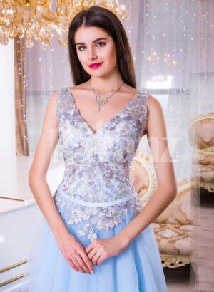 Women's sleeveless evening gown with floor length tulle skirt and flower appliquéd bodice