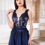 Women's sleeveless navy floor length gown with rich rhinestone studded bodice