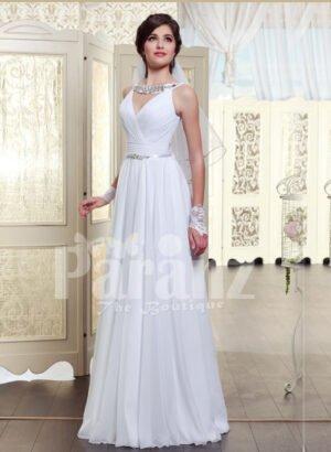 Women's sleeveless pearl white floor length satin gown with glitz waist belt