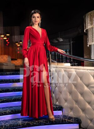 Women's soft and smooth deep red evening gown with side slit skirt and full sleeves
