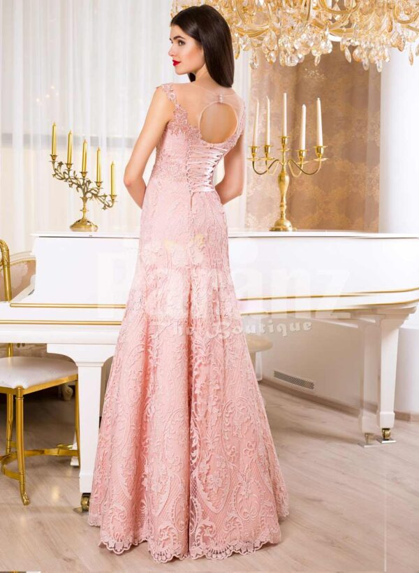 Women's soft light pink mermaid style rich satin gown with same hue appliqués bAack side view