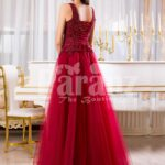 Women's soft maroon floor length tulle skirt gown with rich rhinestone bodice back side view
