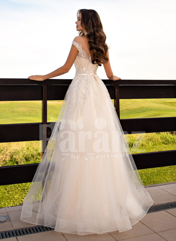 Women's stunning all white tulle wedding gown with royal bodice back side view
