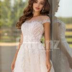 Women's stunning all white tulle wedding gown with royal bodice close view