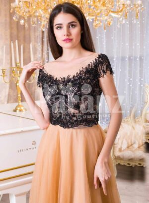 Women's stunning evening gown with lacy black bodice and long peach tulle skirt