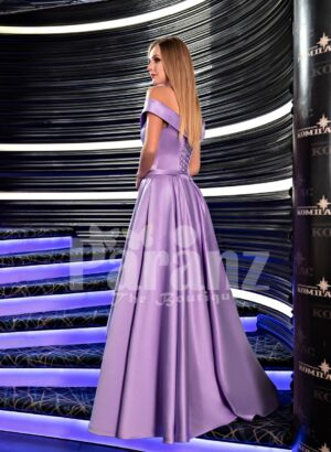 Women's super glam and stylish side slit floor length soft satin gown with off-shoulder bodice back side view
