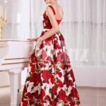 Women's super stylish and fancy rich satin long gown with red rosette prints all over side view