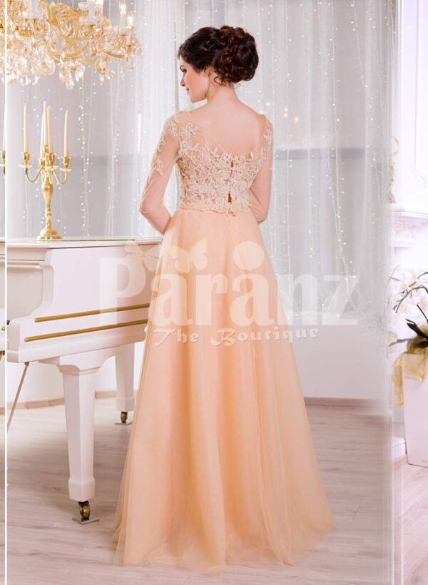 Women's truly glam evening gown with long peachy orange tulle skirt and satin bodice back side view