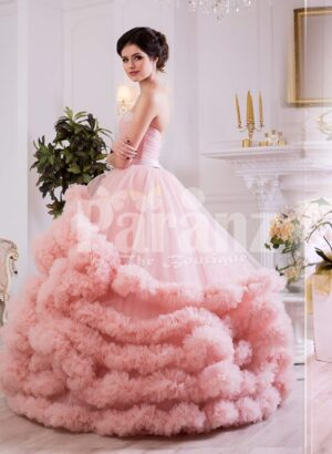 Women's unique elegant evening gown with long tulle skirt with ruffle cloud hem in pink side view