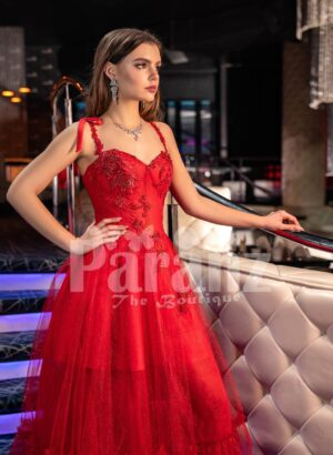 Women's vibrant red floor length tulle frill evening gown with stylish sleeveless bodice