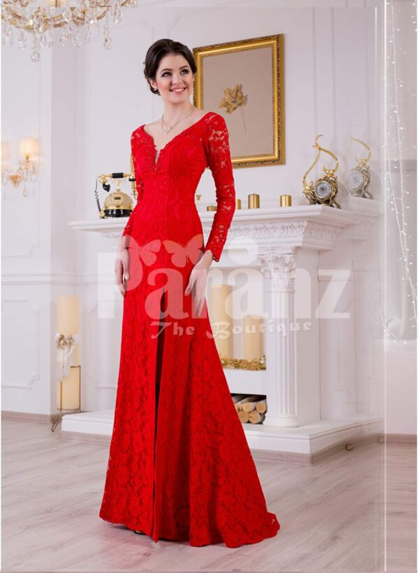 Women's vibrant red side slit full sleeve glam evening gown with all over lace work
