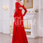 Women's vibrant red side slit full sleeve glam evening gown with all over lace work back side view