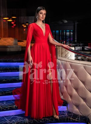Women's vibrant red side slit tulle skirt gown with long frilly sleeves