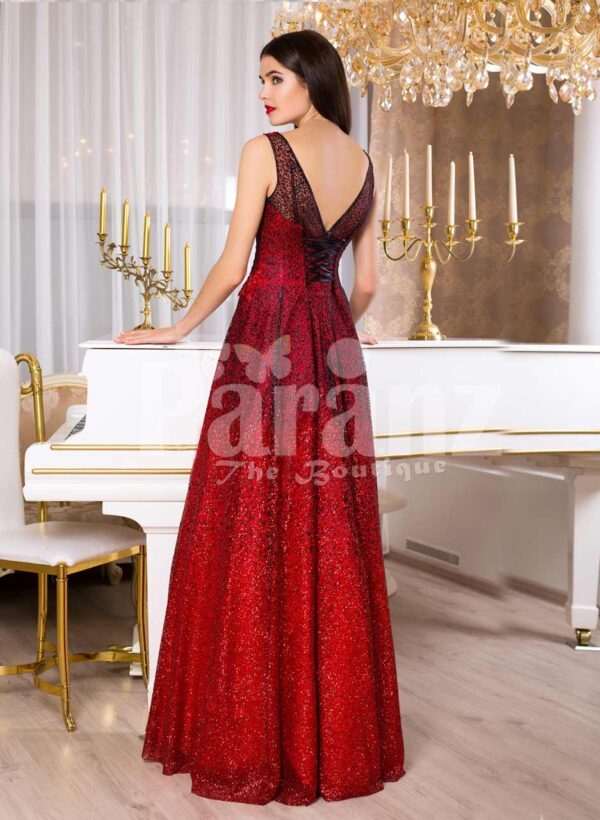 Women's vibrant red sleeveless evening gown with floor length skirt back side view