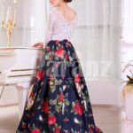 Women's white lacy bodice evening gown with colorful rosette print all over back side view