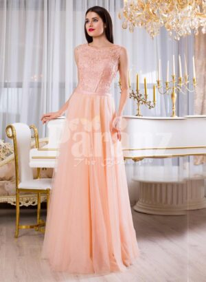Womens floor length tulle skirt evening gown with appliquéd bodice in peach hue