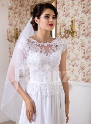 Womens simple and elegant all white floor length lacy bodice wedding gown