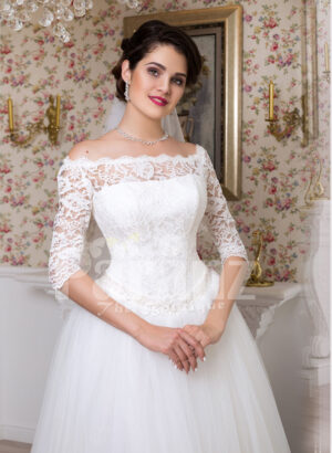 Womens tea length white lacy bodice and tulle skirt wedding gown