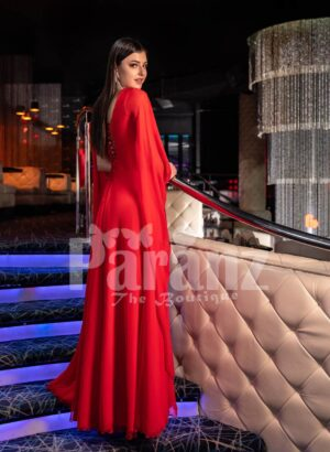 Womens vibrant red side slit tulle skirt gown with long frilly sleeves