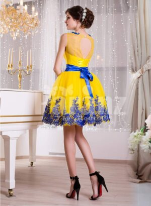 Bright yellow small evening gown with short tulle skirt and rich blue lace work back side view