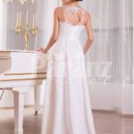 Elegant pearl white sleeveless evening gown with long tulle skirt and lace appliquéd bodice back side view