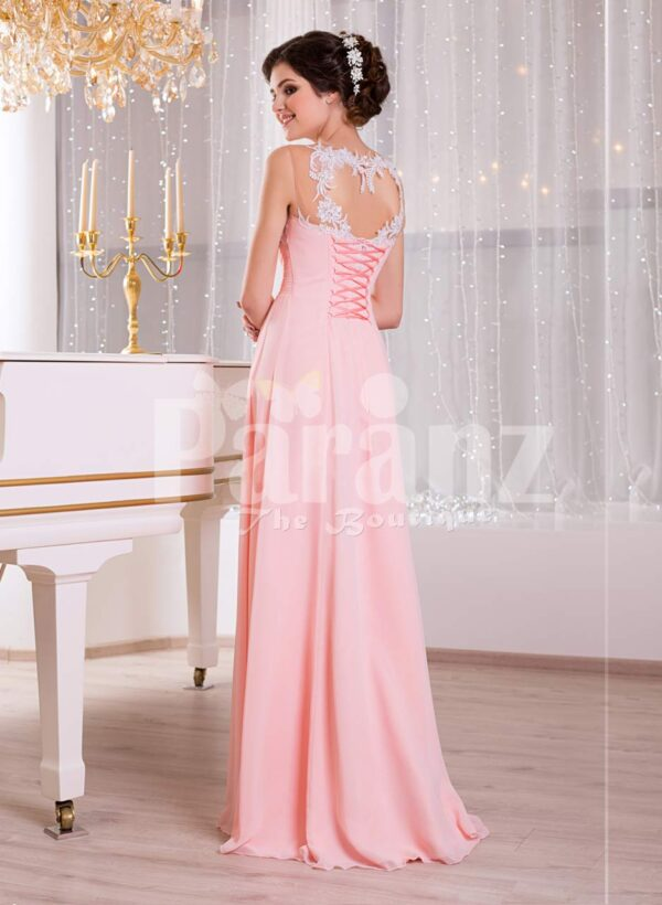 Women's baby pink glam evening gown with lace appliquéd royal bodice and long tulle skirt back side view