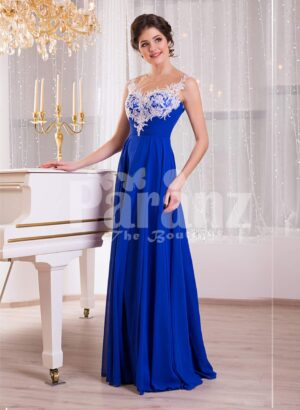 Women's blue floor length sleek tulle skirt evening gown with white floral appliquéd bodice