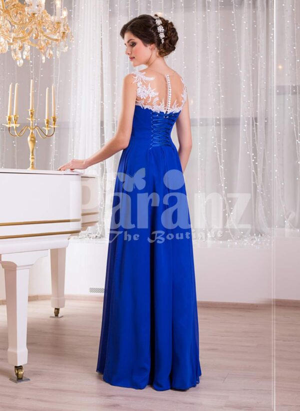 Women's blue floor length sleek tulle skirt evening gown with white floral appliquéd bodice Side view