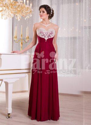 Women's deep maroon floor length sleek tulle skirt dress with white flower appliquéd bodice
