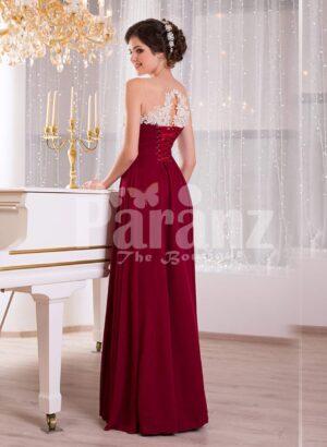 Women's deep maroon floor length sleek tulle skirt dress with white flower appliquéd bodice side view