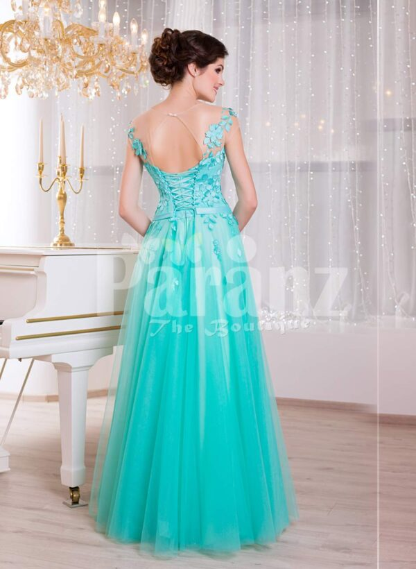 Women's floor length elegant evening gown with mint tulle skirt and floral appliquéd bodice back side view