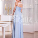 Women's light blue sleek tulle skirt floor length gown with white floral appliquéd bodice side view