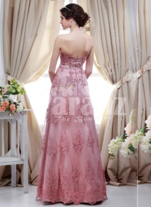 Women's metallic pink off-shoulder evening party gown with floor length lace work skirt back side view
